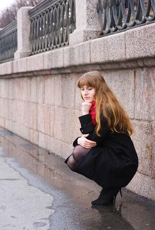 Sad girl with long red hair photo