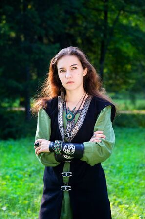 Young woman in medieval suit photo