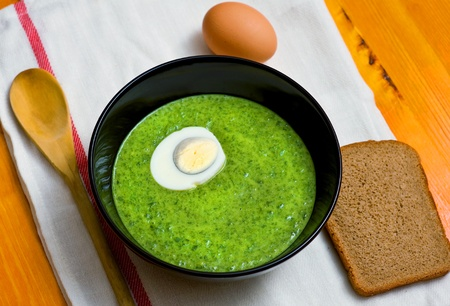 Spinach cream soup with egg photo