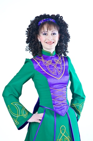 Smiling woman – irish dancer – on the white background photo