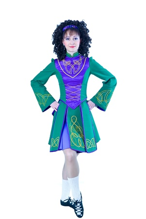 Woman in irish dancing dress on the white background photo