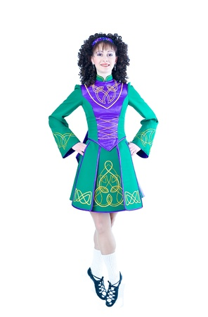 Irish dancer posing on the white background photo