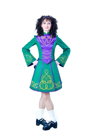 Irish dancer in the hard shoes on the white background photo