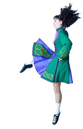 irish woman: Beautiful woman dancing irish dance  Stock Photo