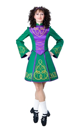 Irish dancer in the hard shoes on the white background