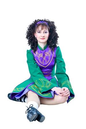 Woman irish dancer sitting  photo