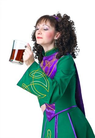 Woman irish dancer drinking beer photo