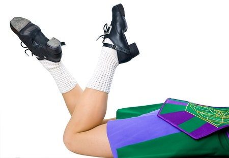irish woman: Legs of woman in shoes for irish dancing and green dress
