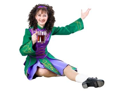 Happy irish dancer sitting with mug of beer Stock Photo - 12660170