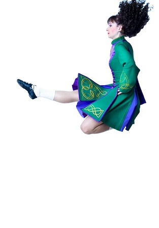 Irish dancer jumping on the white background photo