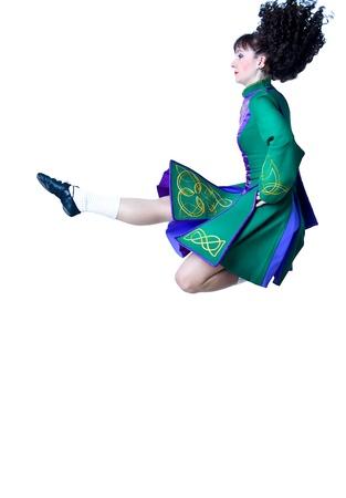 Irish dancer jumping on the white background Stock Photo - 12660130