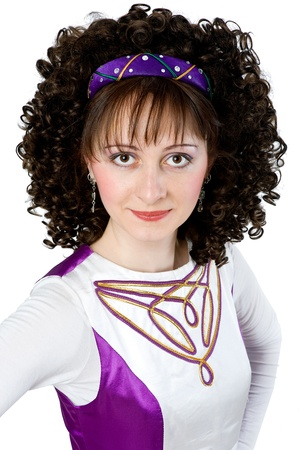 Portrait of beautiful woman in irish dancing costume photo