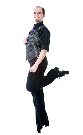 Smiling man dancing irish dance photo