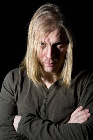 Portrait of man with long hair photo
