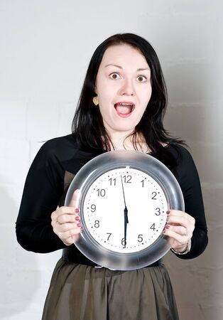 Beautiful brunette woman showing on the clock Stock Photo - 13051665