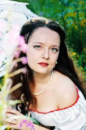 Young beautiful woman with green eyes photo