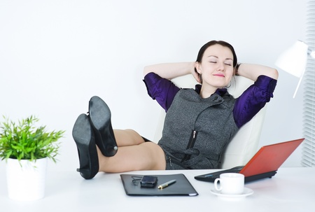 Business woman relax with legs on the table photo
