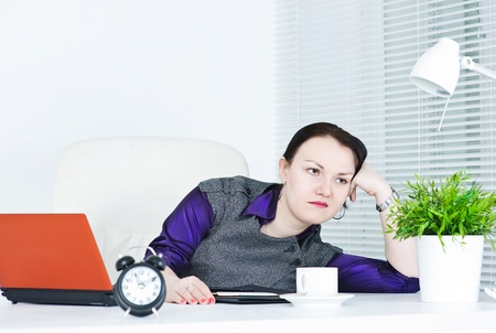 Beautiful business woman bored at work photo