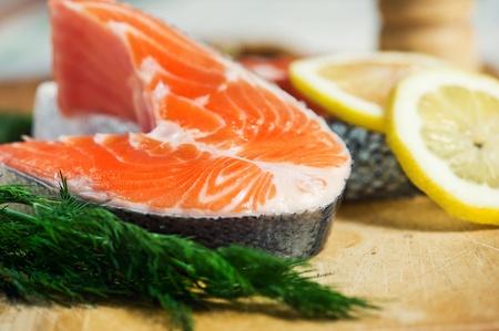Piece of salmon, lemon and fennel photo
