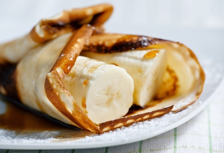 Pancake with banana and maple syrup  photo