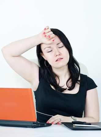 Beautiful business woman tired at work Stock Photo - 13379791