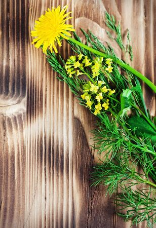 Yellow flowers and grass on the wood background Stock Photo - 13842472