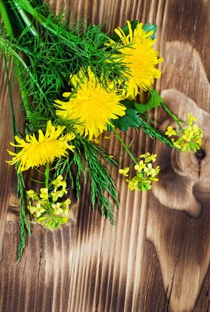 Yellow flowers and grass on the wood background Stock Photo - 13842473