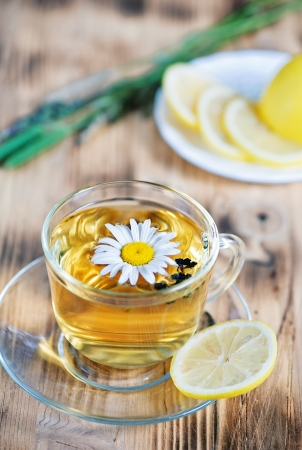 Tea with chamomile, lemons and herbs  photo