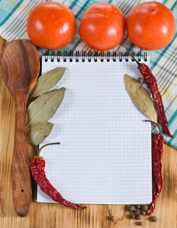Open notebook with vegetables photo