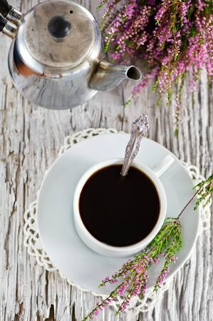Cup of coffee and heather photo