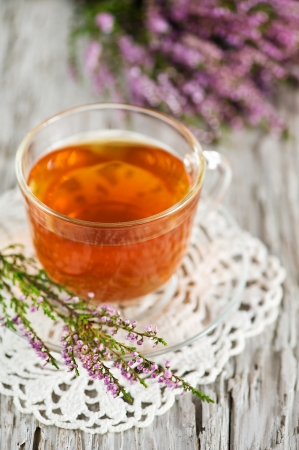 Cup of tea and heather  photo
