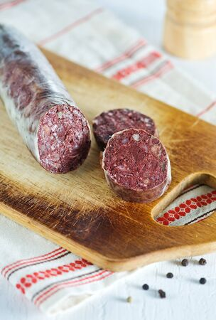 Blood pudding sausage on the chopping board photo