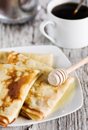 Pancakes with honey and coffee