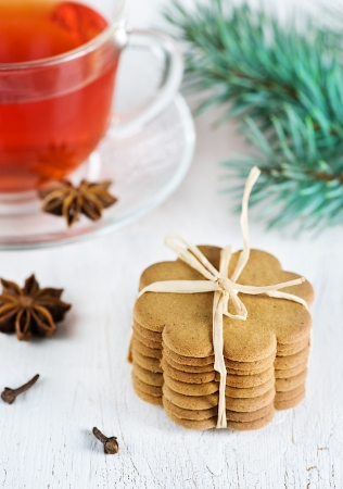 Christmas cookies, cup of tea and fir branch Stock Photo - 16006594