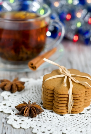 Christmas cookies, cup of tea and decoration photo