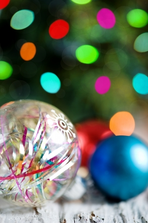 Christmas balls on the shiny blur background photo
