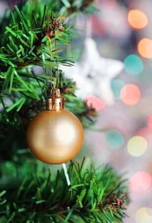 Christmas ball on fir tree branch photo