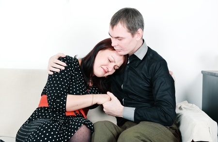 Man comforting her woman on the sofa Stock Photo - 16907819