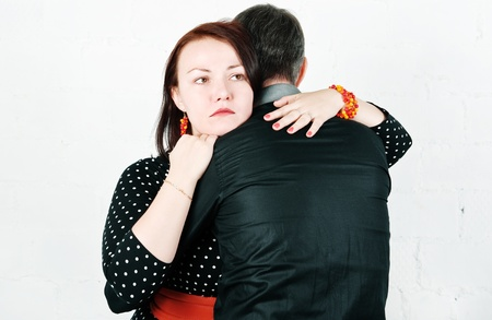 Woman hugging and comforting her man  photo