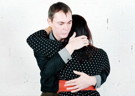 Man hugging and comforting his woman  photo