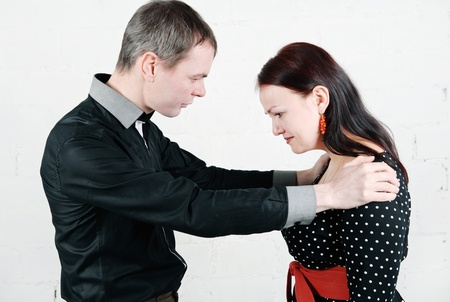 Man comforting and supporting sad woman  photo