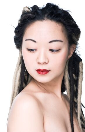 Beautiful asian woman with dreadlocks on the white background photo