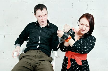 imperious: Imperious man and woman in handcuffs