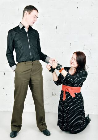 Imperious man and woman in handcuffs on knees Stock Photo - 17538485