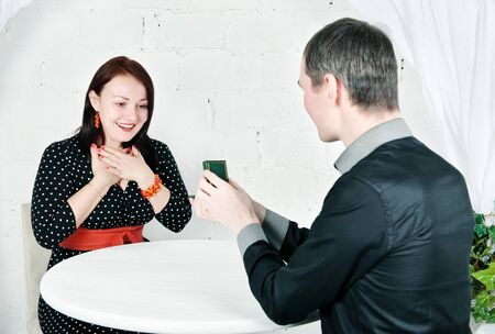 Man propose marriage to surprised woman Stock Photo - 17565312