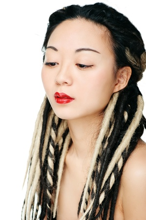 Beautiful asian woman with dreadlocks over white background photo