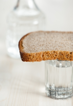 Glass of water, bread and decanter photo