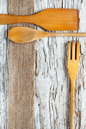 Wooden utensils on the old wooden background Stock Photo - 20824337