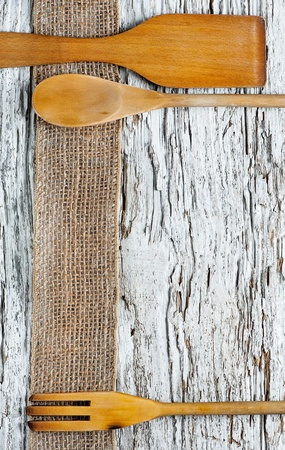 Wooden utensils on the old wooden background Stock Photo - 20824339