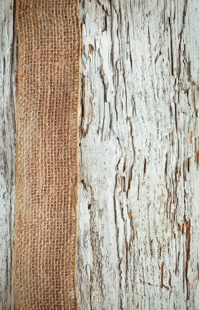 Old rough wooden background with sacking ribbon Stock Photo - 20824358